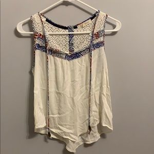 Rewind top with red, white and blue details.